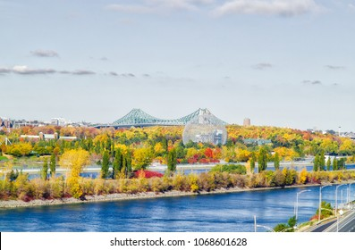 Jacques-Cartier Bridge in Montreal, in automn with the Biodome in foreground. Montreal, Quebec, Canada