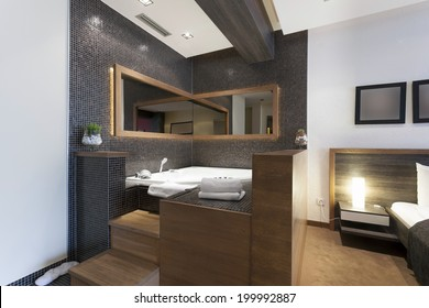 Jacuzzi bath near the bed in luxury living room apartment