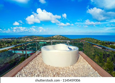Jacuzzi bath is on the top of hill site while the blue sky.