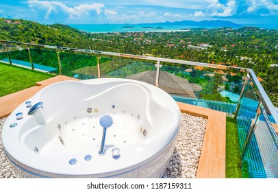 Jacuzzi bath is on the top of hill site while the blue sky in paradise island.Koh Samui Thailand.