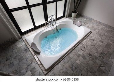 jacuzzi bath tub on marble floor with water