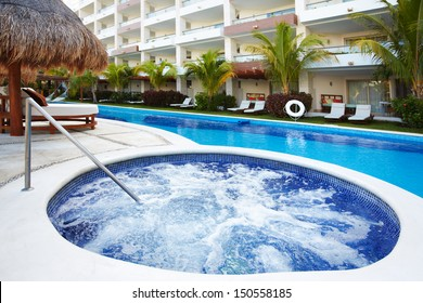 Jacuzzi and a swimming pool at caribbean resort.