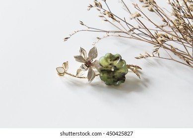 Jade jewelry brooch, white background