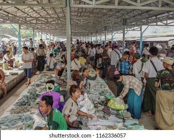 JADE MARKET/ MANDALAY, MYANMAR - APRIL 4, 2018: jade vendors selling little pieces of the precious stone