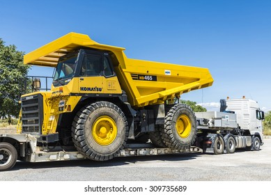 Jaen, Spain - August 18, 2015: Transportation of a large dump truck Komatsu