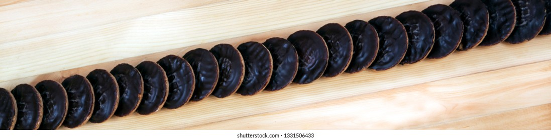 Jaffa cakes panorama, banner and header, as a food background.