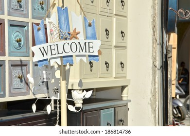 "JAFFA, ISRAEL - APR 11, 2014: a sign saying ""welcome"" and furniture in the Jaffa Flea Market in Tel Aviv, Israel"