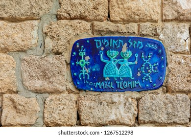 Jaffa, Israel - Dec 22, 2018: Road sign plaque with zodiac sign of the twins in Jaffa