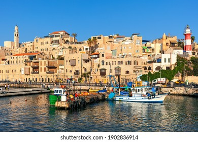 JAFFA, ISRAEL - JULY 21, 2015: Fishing boats and typical houses of old Jaffa - ancient port and famous tourist destination associated with biblical stories as well as mythological.