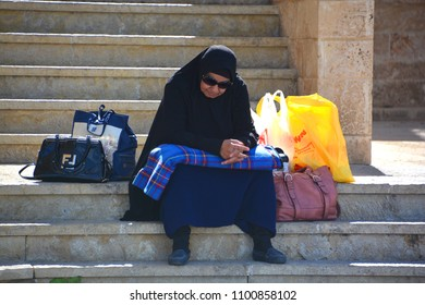 JAFFA ISRAEL OCT 26 2016: Veiled womAn at Jaffa mosque, In July 2010, some Israeli lawmakers and women's rights activists proposed a bill to the Knesset banning face-covering veils.