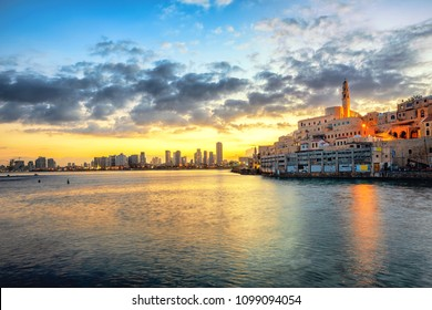 Jaffa Old Town and modern Tel Aviv skyline on dramatic sunrise, Israel