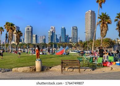 JAFFA-TEL AVIV, ISRAEL - JUNE 26, 2020 : Israeli Arab families have a rest every Friday night  at Charles Clore Park overlooking to  Tel Aviv skyline. Jaffa - Tel Aviv, Israel,
