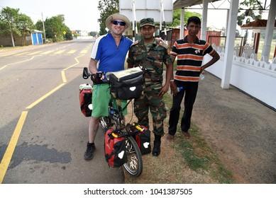 JAFFNA,SRI LANKA - JANUARY 27.2018:cyclist at check point at entrance to the city on January 27,2018 in Jaffna,Sri Lanka