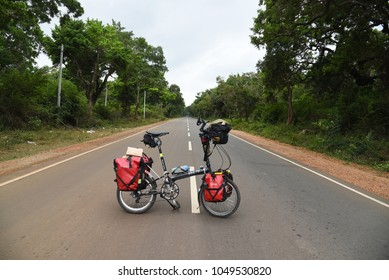 JAFFNA,SRI LANKA - JANUARY 27.2018:folding bike standing at main road to the city on January 27,2018 in Jaffna,Sri Lanka