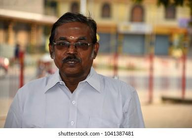 JAFFNA,SRI LANKA - JANUARY 28.2018:tourist guide at hindu temple Nallur Kandaswamy Kovil  on January 28,2018 in Jaffna, Sri Lanka