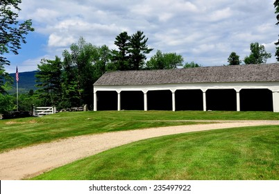 Jaffrey Center, New Hampshire:  A row of wooden stables for parishioner's horse carriages next to the 1775 Original Meeting House church