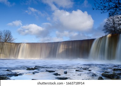 Jagala Waterfall (Jägala juga), the highest natural waterfall in Estonia. Long exposure shot with blue sky background