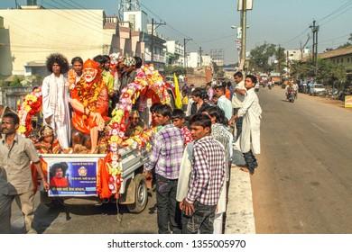 Jagdalpur,25,December,2011: Devoteed carry Idol of Saint Sai Baba on automobile  vehicle with followers as religious procession on Jagdalpur street, Bastar, Chhattisgarh, India.