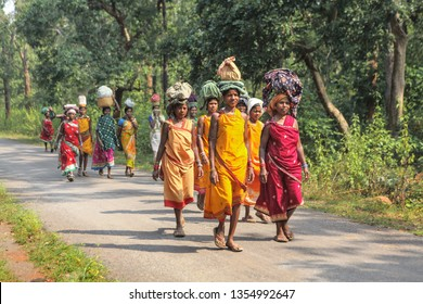 Jagdalpur,October ,21,2012:  Group of tribal women in  traditional  clothes  walk  on foot, long distance through the forest to attend weekly market  at Jagdalpur, Bastar, Chhattisgarh, India.
