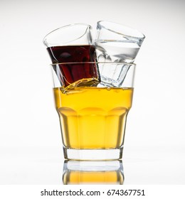Jager bull yellow cocktail in glass, near a shot with white and a shot with brown luqiid