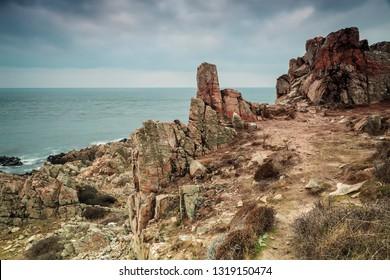 Jagged cliffs in coastal national park. Kullaberg, Sweden.
