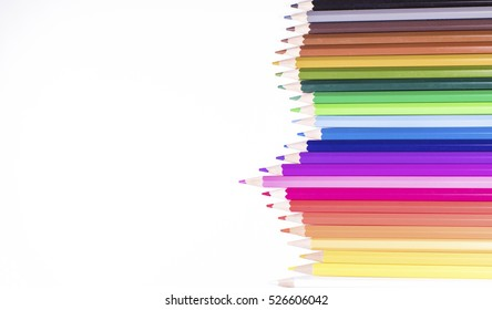 Jagged row of coloured pencils on white with space for text