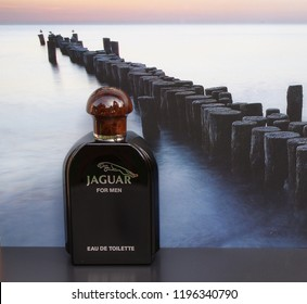 Jaguar for Men, Eau de Toilette, big perfume bottle in front of the picture of a groyne in the sea Kassel, Germany, 09.15, 2018 : Jaguar for Men is a men's fragrance, created by Dominique Preyssas
