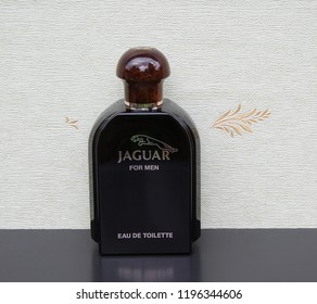 Jaguar for Men, Eau de Toilette, big perfume bottle in front of the satin wallcovering Elysee Kassel, Germany, 09.15, 2018 : Jaguar for Men launched in 1988 created by the perfumer Dominique Preyssas