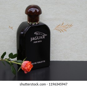 Jaguar for Men, Eau de Toilette, big perfume bottle in front of the satin wallcovering Elysee decorated with a rose Kassel, Germany, 09.15, 2018 : Jaguar for Men created by the perfumer D. Preyssas