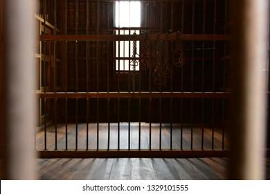 Jail  Prison Grille room punishment vintage wooden and metal bars.