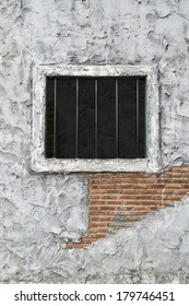 jail window and old weary wall
