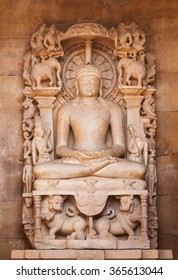 The Jain's statue on a throne in an environment of elephants, lions, deities and mythical animals, made of sandstone. An altar in Adinath Temple, Khajuraho.