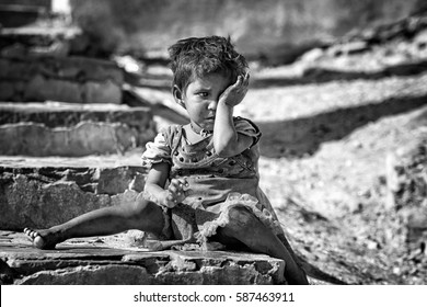 JAIPUR - DEC 29: young homeless child crying on the street on 29 December 2016, in  Jaipur, India. About 1.77 million people are homeless in India -  0.15% of the country's total population.
