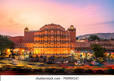JAIPUR - DECEMBER 15, 2017: The crowd and vehicles in front of Hawa Mahal, India at the evening.