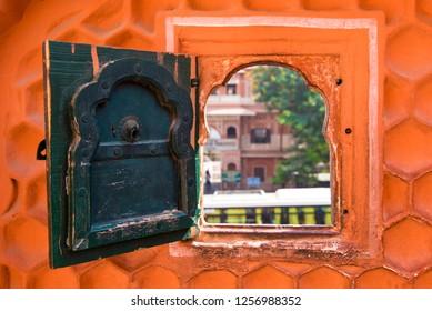 Jaipur / India 16 November 2018 Small Secret Window to see outside of the Hawa Mahal or Wind Palace at Jaipur in Rajasthan India