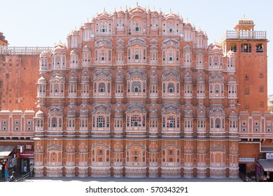 JAIPUR, INDIA - 22ND MARCH 2016: The front of the Hawa Mahal (Palace of the Winds) in central Jaipur. People can be seen.