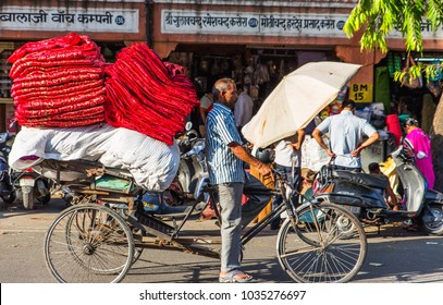 JAIPUR INDIA 25.02.2018 - indian rides a bicycle overloaded with various goods