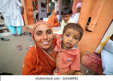 JAIPUR, INDIA - APRIL, 2013: portrait of an Indian mother and child