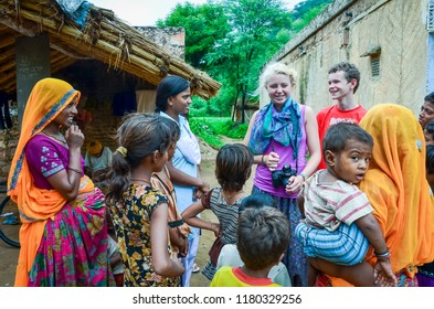 Jaipur / India - August 12, 2012: Young American tourists visit a rural village near Jaipur, India.