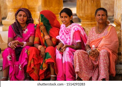Jaipur, India - August 20, 2009: group of women sitting and talking, dressed in typical Indian robes in the fort of Jaipur in India