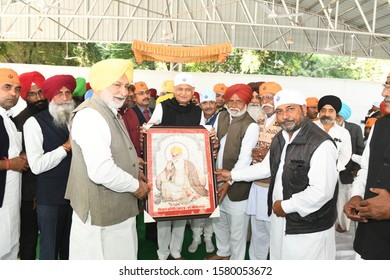 Jaipur, India - Dec. 4, 2019: Sikh community presents an picture to Rajasthan Chief Minister Ashok Gehlot during the Shabad Kirtan held on the occasion of 550th Anniversary of Shri Guru Nanak Dev ji.