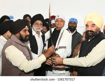 Jaipur, India - Dec. 4, 2019: Sikh people presents an iron sword to Rajasthan CM Ashok Gehlot during the Shabad Kirtan held on the occasion of 550th Anniversary of Shri Guru Nanak Dev ji at Jaipur.