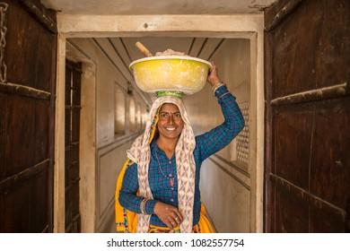 JAIPUR - INDIA - DECEMBER 2 2017. Portrait of a beautiful smiling Indian women laborers at work restoring an old palace, Jaipur, Rajasthan, India.