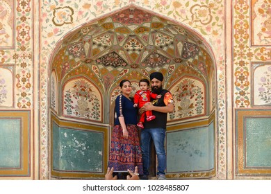 JAIPUR, INDIA - DECEMBER 20, 2015: Indian family inside of Amber Palace