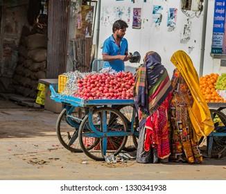 JAIPUR - INDIA -Feb 7-Merchant sells fresh fruit and vegetables