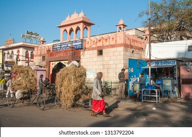 JAIPUR, INDIA - FEBRUARY 2, 2011: Rickshaws transporting hay in the morning traffic of Japiur, which is the largest city in Rajasthan with a population of 3-4 million.