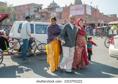 JAIPUR, INDIA - FEBRUARY 2, 2011: Pedestrians crossing a street in the morning traffic of Japiur, which is the largest city in Rajasthan with a population of 3-4 million.