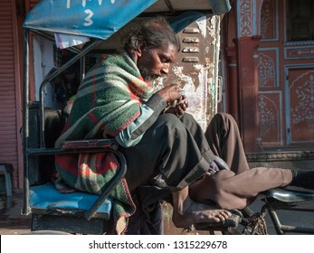 JAIPUR, INDIA - FEBRUARY 2, 2011: Rickshaw driver takes a break in Jaipur. Jaipur is the largest city in Rajasthan with a population of 3-4 million.