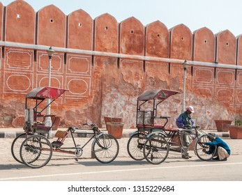 JAIPUR, INDIA - FEBRUARY 2, 2011: Rickshaw drivers repair a rickshaw in Jaipur. Jaipur is the largest city in Rajasthan with a population of 3-4 million.
