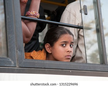 JAIPUR, INDIA - FEBRUARY 2, 2011: Girl on a bus in Jaipur. Jaipur is the largest city in Rajasthan with a population of 3-4 million.